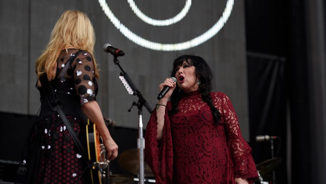 Ann Wilson, right, and Nancy Wilson, left, of Heart perform at RFK Stadium on Saturday, July 4, 2015, in Washington.
