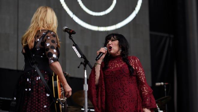 Ann Wilson, right, and Nancy Wilson, left, of Heart perform at RFK Stadium on Saturday, July 4, 2015, in Washington.