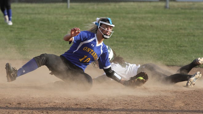 Ontario's Mackenzie Snow looks for a call as Madison's Sloan Kiser makes it safely to second base during a home game on Thursday.