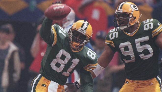 The Packers' Desmond Howard celebrates his third-quarter kickoff return for a touchdown against the New England Patriots during the Super Bowl, January 26, 1997, at the Superdome in New Orleans.