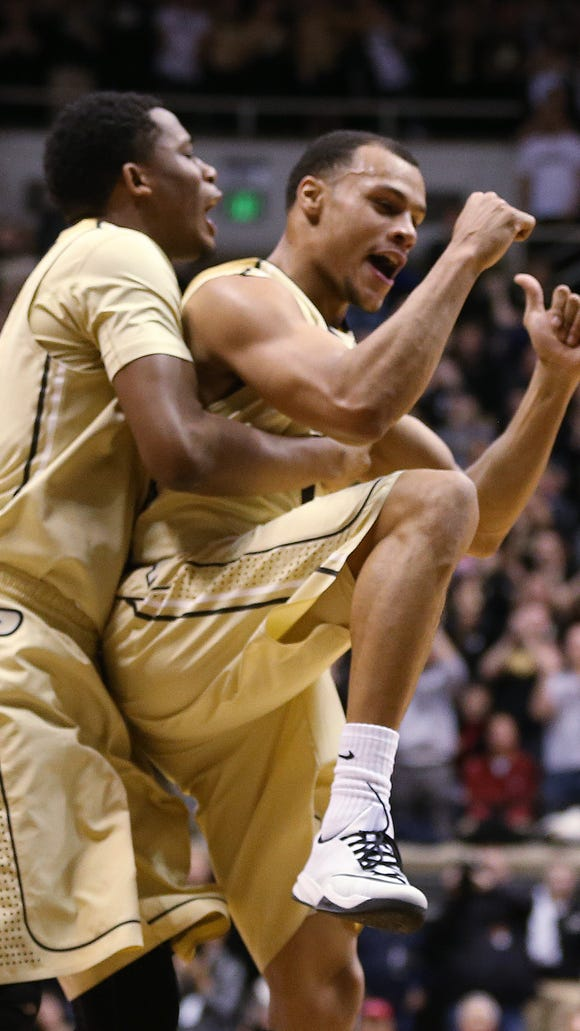 Purdue Boilermakers forward Basil Smotherman and teammate