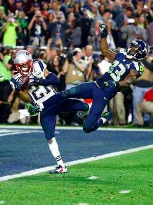 Feb 1, 2015; Glendale, AZ, USA; New England Patriots strong safety Malcolm Butler (21) intercepts a pass intended for Seattle Seahawks wide receiver Ricardo Lockette (83) in the fourth quarter in Super Bowl XLIX at University of Phoenix Stadium.