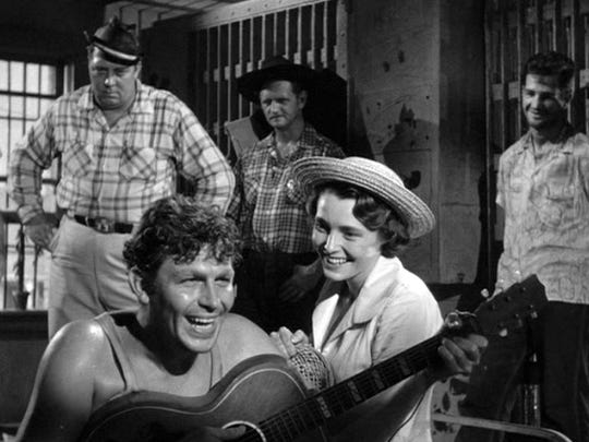 Andy Griffith, miles and miles from Mayberry, plays Lonesome Rhodes, a drunken drifter that Marcia Jeffries, a producer of a radio show, runs across in an Arkansas jail.