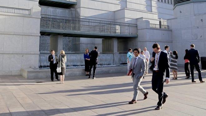 Members of The Church of Jesus Christ of Latter-day Saints gather Sunday morning for their faith's General Conference at the Conference Center in Salt Lake City.
