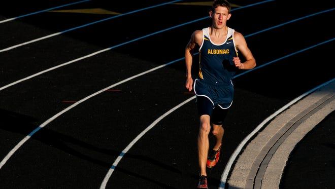 Algonac senior Morgan Beadlescomb competes in the mile run.