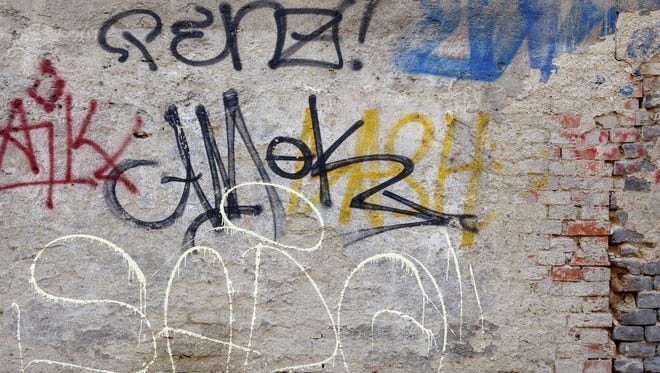 Getty Images/iStockphoto grunge background with graffiti elements