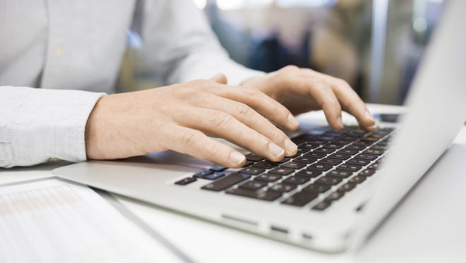 Man Typing on a keyboard laptop at office, email, message