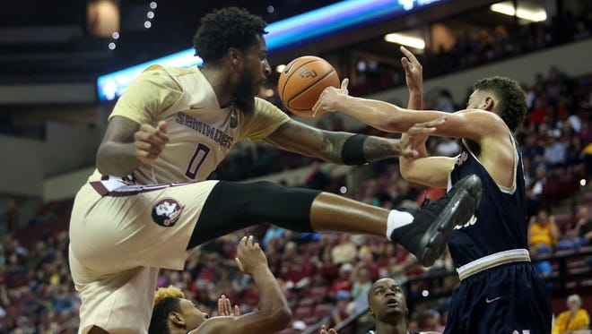 FSU forward Phil Cofer jumps for a rebound during Florida State's game against Charleston Southern University at the Tucker Civic Center Monday.