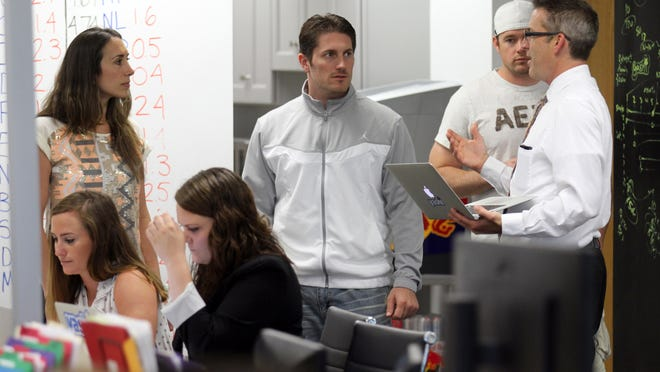 (Left to right) Yashi founders Caitlin and Jay Gould listen as Mark Schmidhauser, director of Mid-Atlantic sales at Yashi, speaks with them in this 2014 file photo. The Toms River tech company was bought for $33 million by Nexstar Broadcasting Gorup last week.