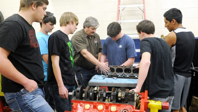 Roy Call works with Wylie High School students in the automotive program at Cisco College.