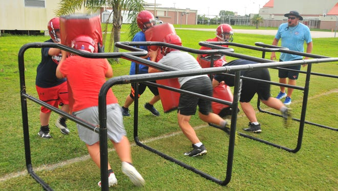The first day of Cocoa Beach Jr./Sr. High School  football practice.