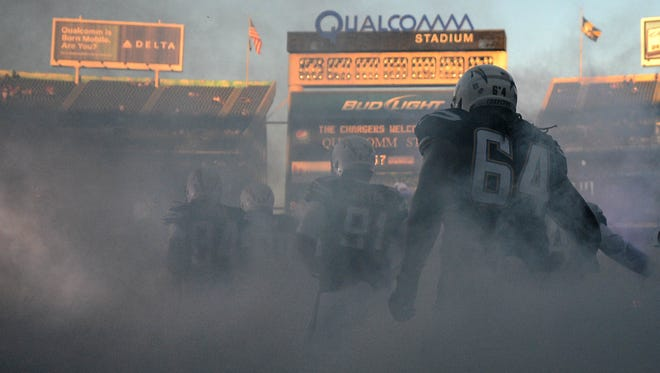 The San Diego Chargers  take the field against the Arizona Cardinals during a 2014 preseason game at Qualcomm Stadium.