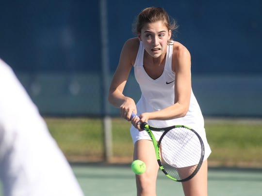 St. John Paul II's Sara Grace Rooney tracks down a ball during a doubles match.