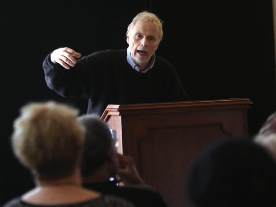 Jeffrey B. Perry speaks about race issues at the Wilmington Library Friday.