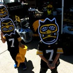 Carson Smith of Raleigh, left, and Chase Wilbur of Cleveland tailgate outside Kinnick Stadium on Saturday, Sept. 13, 2014.