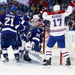Apr 16, 2014; Tampa, FL, USA; Tampa Bay Lightning goalie Anders Lindback (39) looks up as Montreal Canadiens left wing Rene Bourque (17) celebrates after Montreal Canadiens center Lars Eller (81) (not pictured) scored a goal during the third period in game one of the first round of the 2014 Stanley Cup Playoffs at Tampa Bay Times Forum. Montreal Canadiens defeated the Tampa Bay Lightning 5-4.