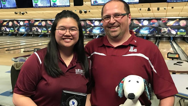 "Leonia junior Gabrielle Capalad captured the Bergen County girls bowling high series award on Saturday, Jan. 20, 2018 with the support of coach Chris Kotwica and good-luck ""mascot"" Snoopy."
