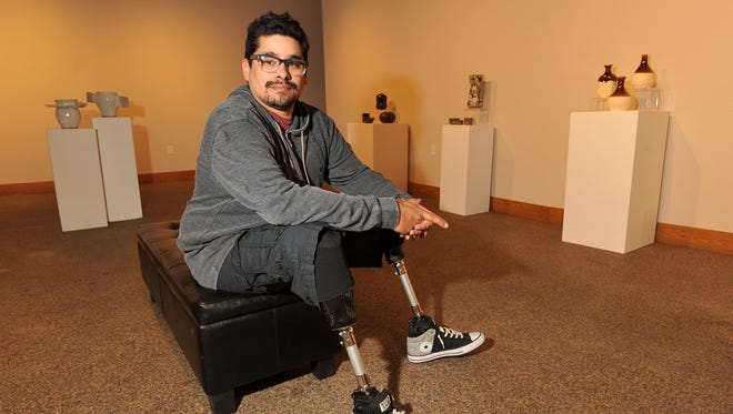 Judas Recendez, a ceramics and mixed media artist, will be featured at Arts Visalia from Jan. 6-29. He's pictured at Arts Visalia on Tuesday, January 5, 2016.