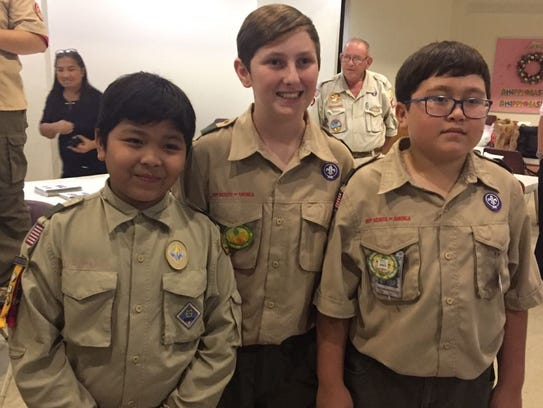 Three Scouts participated in a Crossover Ceremony signifying