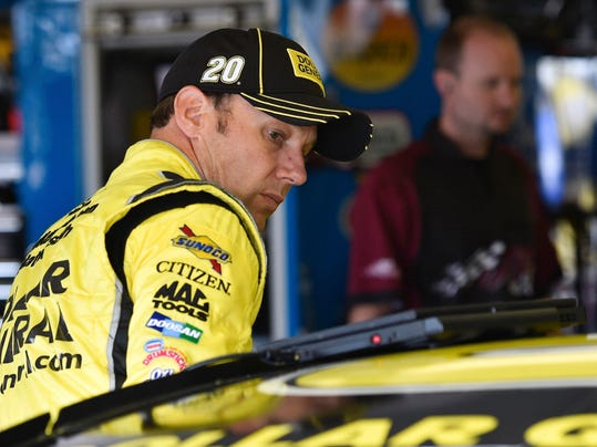 FILE - In this June 5, 2015,file photo, Matt Kenseth (20) waits in the garage area at Pocono Raceway during practice for a NASCAR Sprint Cup auto race in Long Pond, Pa. NASCAR suspended Kenseth for two races on Tuesday for intentionally wrecking Joey Logano in an act of retaliation that carried heavy championship consequences. (AP Photo/Derik Hamilton, File)