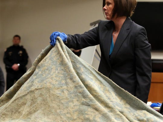 Opening statements were heard in the Michelle Lodzinski murder trial in the courtroom of Judge Dennis Nieves, Middlesex County Superior Court in New Brunswick on Wednesday March 16, 2016. Here, Middlesex County Assistant Prosecutor Christie Bevacqua shows the jury a blanket, part of her evidence during the trial.