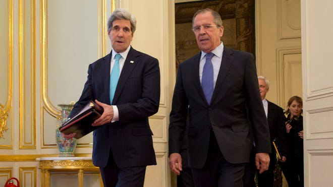 U.S. Secretary of State John Kerry, left, meets with Russian Foreign Minister Sergey Lavrov at the Russian ambassador's residence in Paris to discuss Ukraine on March 30, 2014.