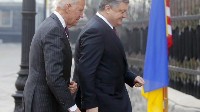 In this Jan. 16, 2017, file photo Vice President Joe Biden, left, and Ukrainian President Petro Poroshenko go for talks during Biden's visit in Kiev, Ukraine.