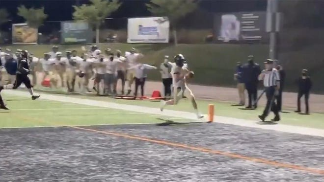 Butler's Cooper Baxter scores on his strange two-point conversion.