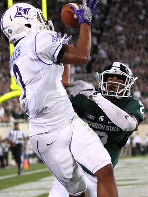 Michigan State cornerback Darian Hicks breaks up a pass intended for Furman receiver Andrej Suttles during the second quarter on Sept. 2 in East Lansing. It was one of Hicks' game-high three pass-breakups.
