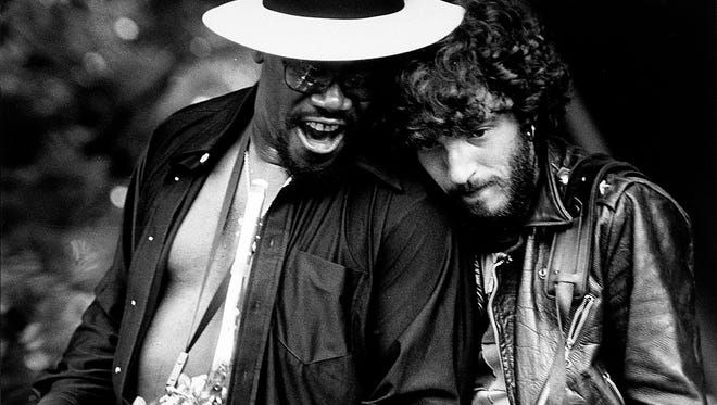 """Bruce Springsteen and Clarence Clemons perform on stage during the third stop of the """"Born to Run"""" tour at Music Inn in Lenox, MA on July 23, 1975."""