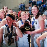 The Susquehanna Valley players celebrate with the state championship plaque after their 51-45 win against Hoosick Falls in the New York State Public High School Athletic Association girls' Class B final on Saturday in Troy.
