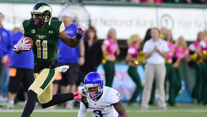 CSU's Jordon Vaden runs away from Boise State's Chancellor James during a game last season at Hughes Stadium. Vaden, a senior, is moving from receiver to cornerback this spring, coach Mike Bobo said Tuesday.