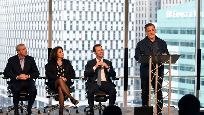 Dan Gilbert, chairman and founder of Rock Ventures and Quicken Loans Inc., gives his remarks during the press conference announcing a Microsoft Detroit office moving into the One Campus Martius building.  From left, Phil Sorgen, Corporate VP Microsoft; Tracey Galloway, Great Lake District, Microsoft, and Jim Ketai, CEO & Managing Partner, Bedrock Detroit.