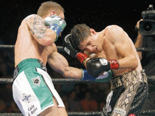 MARK LAMBIE—EL PASO TIMES Irish boxer Carl Frampton successfully defended his IBF super bantamweight title against Mexico's Alejandro Gonzalez Jr. Saturday at the Don Haskins Center.