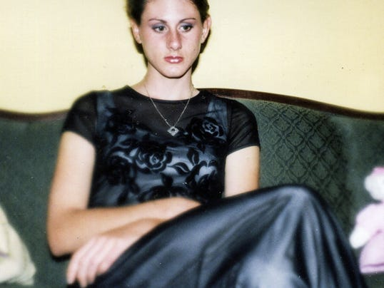 Angela Hawley, in this undated photo provided by her family, died of a heroin overdose in 2014, leaving behind four children. Her stepfather said he and her mother begged her not to continue her drug use, which started with painkillers before graduating to heroin.
