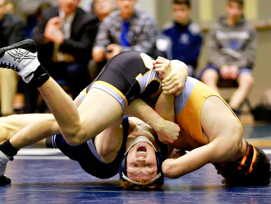 Central York's Mason Myers, right, wrestles Dallastown's Dalton Daugherty in a match from last season. Myers is coming off an invitational championship over the weekend at Brandywine Heights. Dawn J. Sagert photo