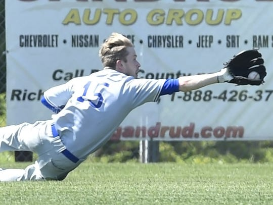 Institute's Jon Baudhuin makes a catch in the outfield