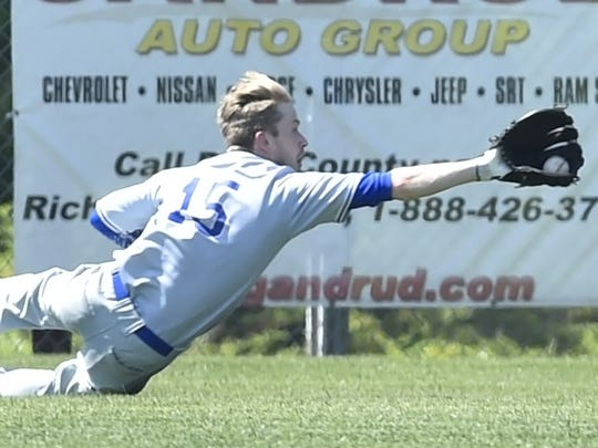 Institute's Jon Baudhuin makes a catch in the outfield against Sister Bay during Door County League play Sunday.