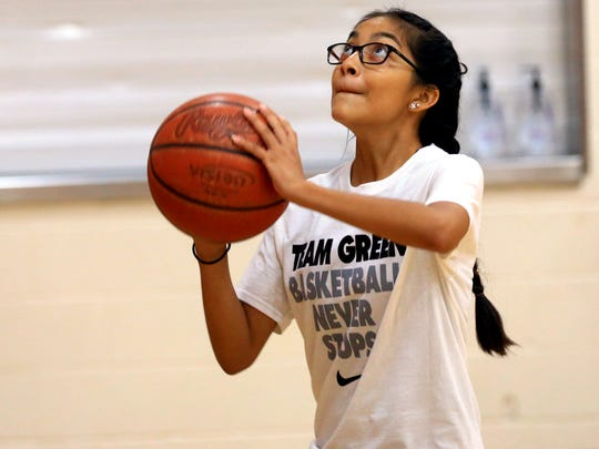 Athletes work on basketball skills during the Danny Green Skills Clinic on Wednesday, July 12, 2017, at Incarnate Word Academy in Corpus Christi.