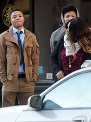 Daishon Richardson, left, prepares to cross North George Street in York city as he makes his way into the judicial center for his preliminary hearing in the rape of a 14-year-old girl outside of the York Fair last year.