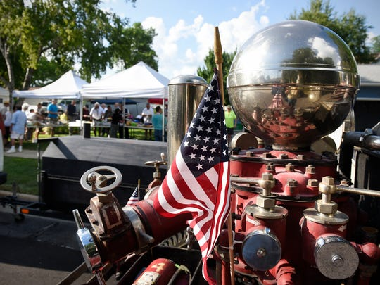 A 1929 Ahrens-Fox St. Cloud fire engine provides a colorful foreground for the National Night Out party in August 2016 at 133-14th Ave. S in St. Cloud. The gathering was one of more than 45 neighborhood events in St. Cloud.