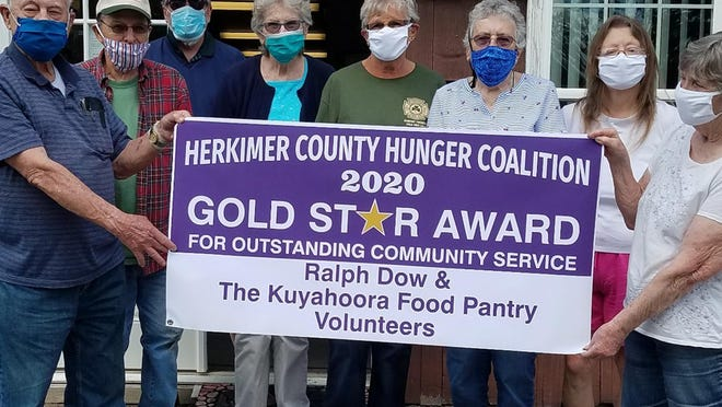 The Kuyahoora Valley Food Pantry was honored with a Gold Star Award for Outstanding Community Service by the Greater Herkimer Lions Club and Herkimer County Hunger Coalition. Pictured from left to right: Dow, Brian Bunce, Ray Lenarcic, Mary Ratajack, Doris Waldruth, Maxina Schultz, Caroline Stewart and Evelyn Stephon.