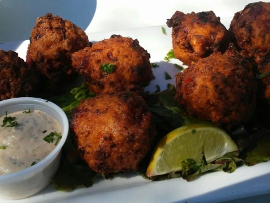 12A Buoy's Bahamian-style conch fritters is loaded with slivers of conch, red and green bell pepper speckles and onion. The spicy Caribbean sauce was tasty, although the fritters had a ton of flavor all on their own.