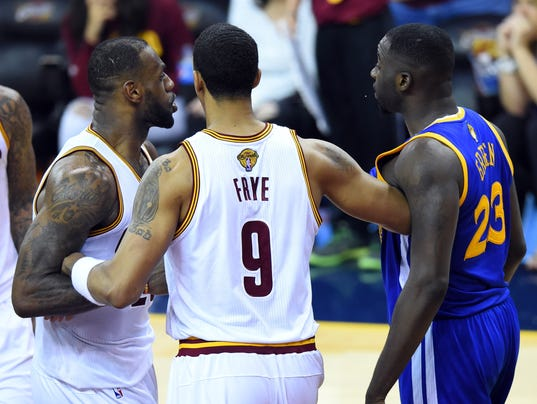 Tempers flare between Draymond Green and LeBron James in ...