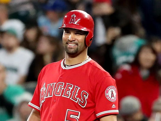 Albert Pujils of the Los Angeles Angels smiles on base after hitting a single in the fifth inning against the Seattle Mariners to reach 3,000 career hits.