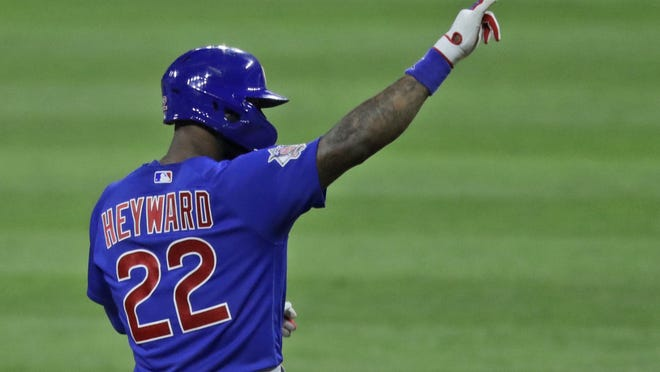 Chicago Cubs' Jason Heyward points toward the dugout after hitting a one run double in the ninth inning in a baseball game against the Cleveland Indians on Wednesday.