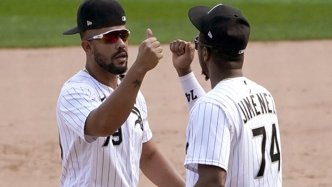 Chicago White Sox's Jose Abreu (79) and Eloy Jimenez celebrate the team's 4-3 win over the Minnesota Twins in  baseball game Thursday, Sept. 17, 2020, in Chicago. The White Sox clinched a playoff spot for the first time since 2008.