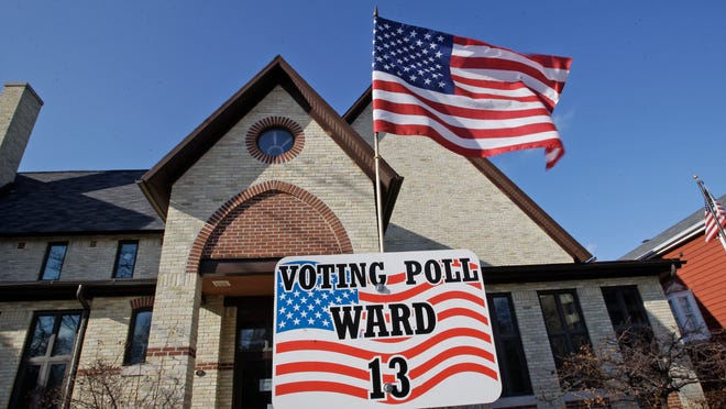 The flag of the United States flutters in the wind at the 13th ward polling place at Grace Episcopal Church Tuesday April 1, 2014 in Sheboygan.