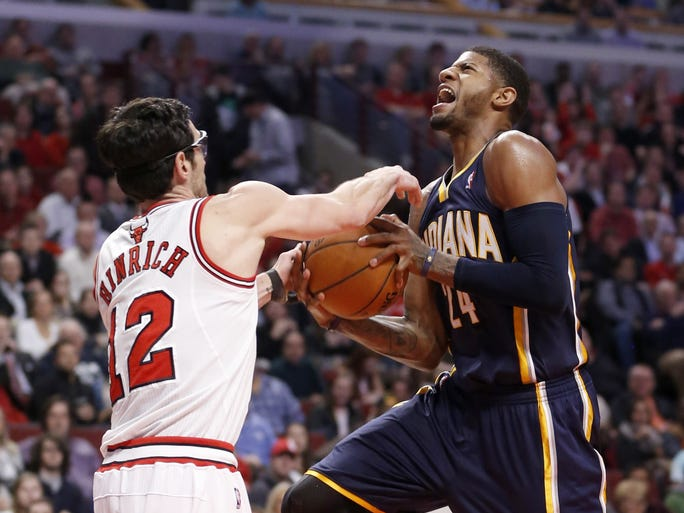 Chicago Bulls guard Kirk Hinrich (12) strips the ball from Indiana Pacers forward Paul George (24) during the second half of an NBA basketball game Monday, March 24, 2014, in Chicago. The Bulls won 89-77. (AP Photo/Charles Rex Arbogast)