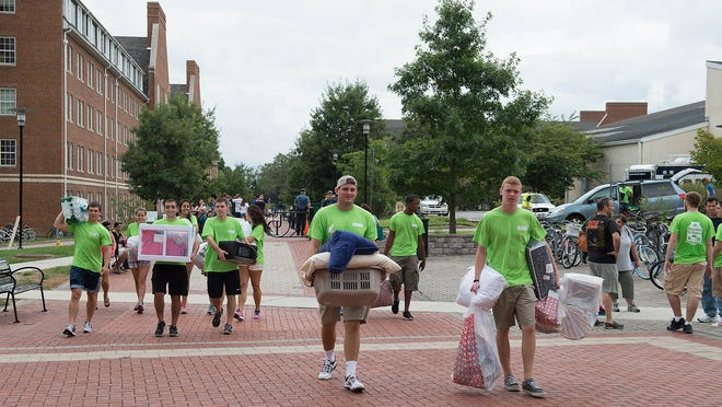 Freshmen moving into their dorm rooms at the University of Delaware on Saturday.
